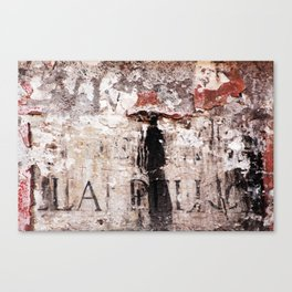 Painted wall with woman in black Canvas Print