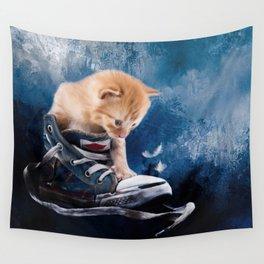 Cute kitten plays in sneakers Wall Tapestry