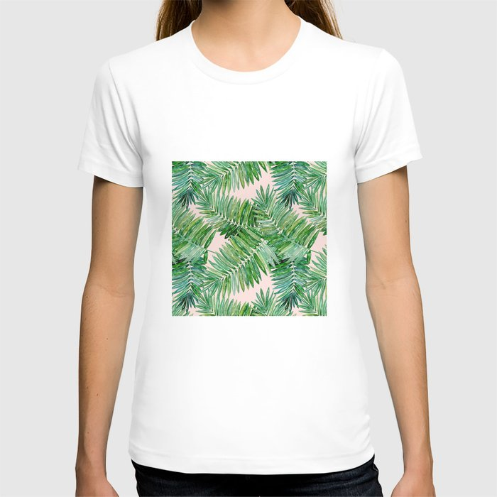 Green palm leaves on a light pink background. T-shirt