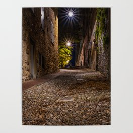 Medieval street that goes up narrow towards Bergamo Alta in the night Poster