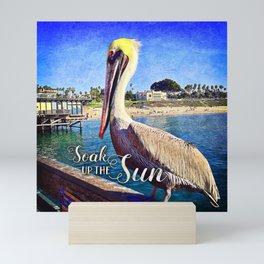 California beach pier pelican | Soak up the Sun Mini Art Print