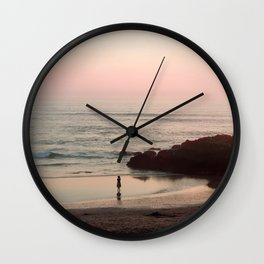 she is water Wall Clock