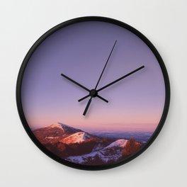Under a blue sky Wall Clock