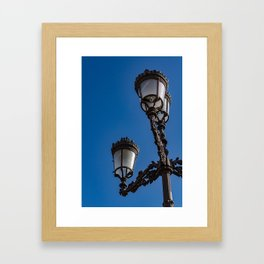 Old iron lamp with three heads Framed Art Print