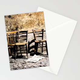 Three chairs and newspaper Stationery Cards