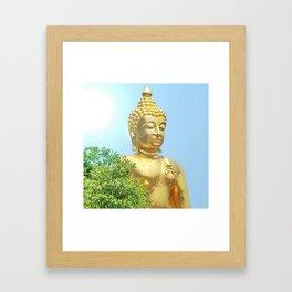 sitting budda in blue sky Framed Art Print