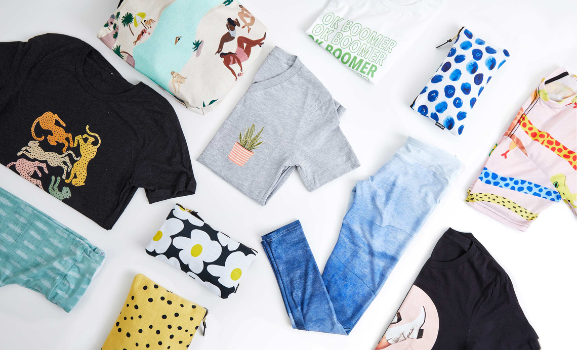 flatlay with t-shirts, leggings, tote bags and more