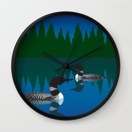 Loons in a pond Wall Clock