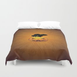 Black kitten on big Halloween pumpkin Duvet Cover