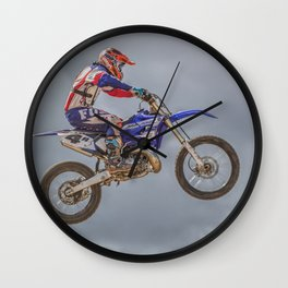 Action motocross biker in blue and red Wall Clock