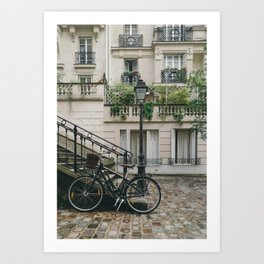 BIKE LEANING AGAINST HANDRAIL IN FRONT OF CONCRETE BUILDING AT DAYTIME Art Print