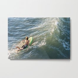 Surfer paddles out on surfboard without a wetsuit Metal Print