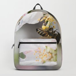 Bee collects pollen sitting on the apple tree flower Backpack