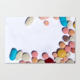 Numerous colorful pills on white background. Canvas Print