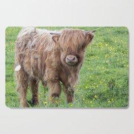 Baby highland cow Cutting Board