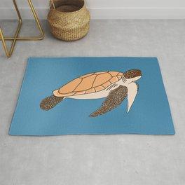 Turtle in the deep blue sea Rug