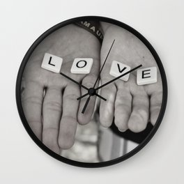 Love- a couple holding tiles spelling Wall Clock