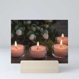 Christmas card with flowers and burning tea candles Mini Art Print
