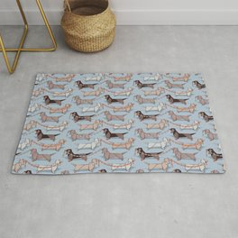Origami Dachshunds sausage dogs // pale blue background Rug