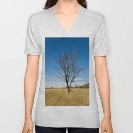 Lone dry tree in serene scene with blue sky Unisex V-Neck