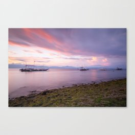 Long exposure shot of the magnificent sunset at the beach Canvas Print