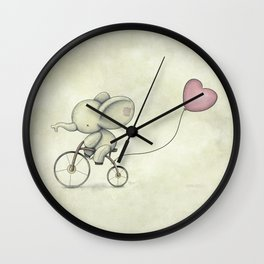 Cute Elephant riding his bike Wall Clock