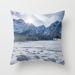Sunny winter day at snowy frozen lake Fusine Throw Pillow