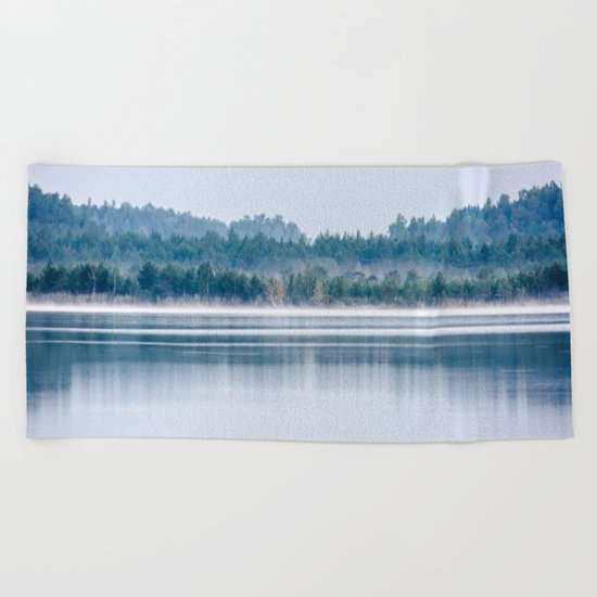 Morning begins with mist Beach Towel