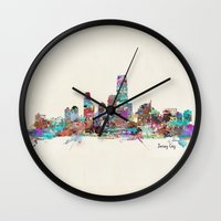 new jersey Wall Clocks featuring jersey city new jersey skyline by bri.buckley