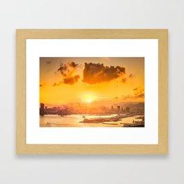 warm color tone orange sunset over hong kong urban city skyline at seafront Framed Art Print