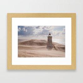 Sandstorm at the lighthouse Framed Art Print