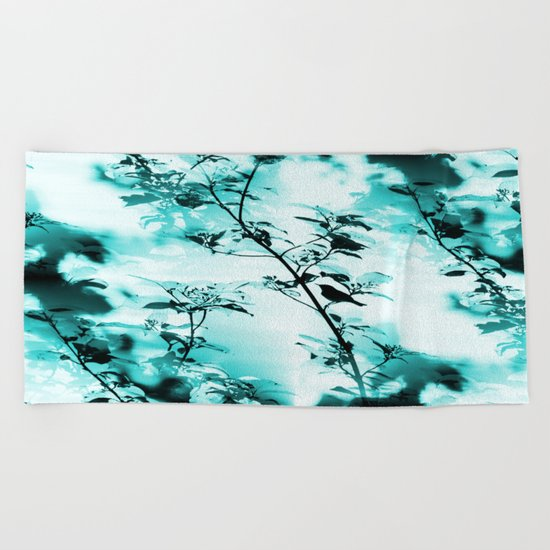 Silhouette of songbird on a branch in turquoise variation  Beach Towel
