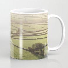 Hazy light at sunset over a valley of fields. Derbyshire, UK. Mug