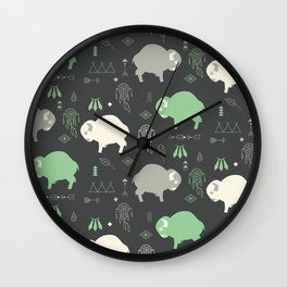 Seamless pattern with cute baby buffaloes and native American symbols, dark gray Wall Clock