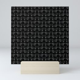 White dachshunds in black background Mini Art Print