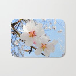 plum tree blossoms closeup Bath Mat