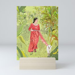 Lady with saree tied to Goat Mini Art Print