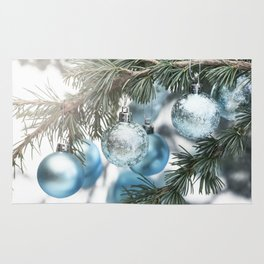 Blue Christmas baubles on tree Rug