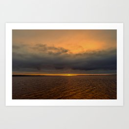 Thundercloud in sunlight sunset over the water Art Print