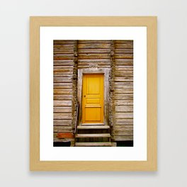 What lies behind the orange door? Framed Art Print