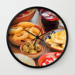 II - Assortment of Spanish tapas and sangria on a rustic table Wall Clock
