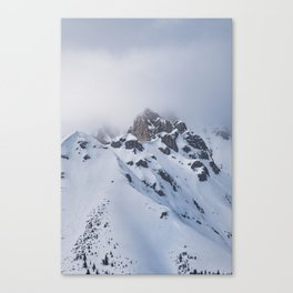 Snow covered mountain top with clouds in Austria Canvas Print