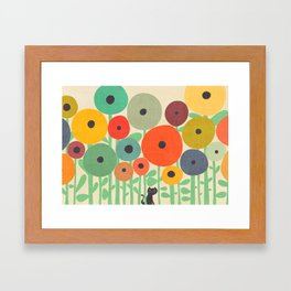 Cat in flower garden Framed Art Print