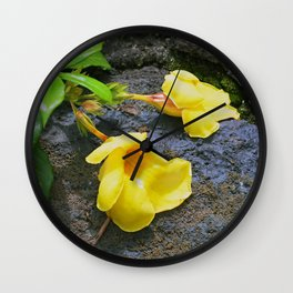 Tropical Yellow Flowers in Repose on Ocean Rocks Wall Clock