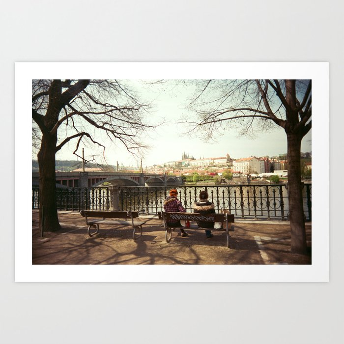 Two Women Sitting on a Bench in Prague Art Print