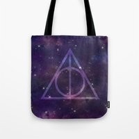 deathly hallows Tote Bags featuring Deathly Hallows in Space by Hannah Ison