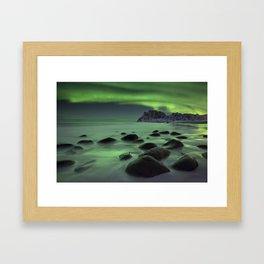 Aurora borealis over a beach on the Lofoten in Norway Framed Art Print