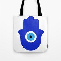 evil eye Tote Bags featuring Evil Eye by Marcaccini Studios
