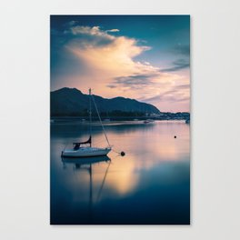 A boat on the river Canvas Print