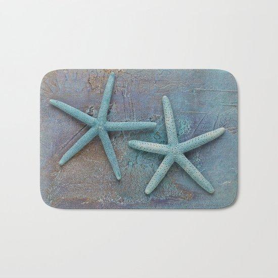 Turquoise Starfish on textured Background Bath Mat